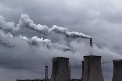 cloudy sky with smoking power coal station Stock Photography