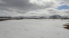 Wide View. Winter Landscapes. Cloudy sky snow and ice cover on pasture Winter Landscapes with volcano view In Iceland royalty free stock photos