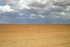Cloudy sky before storm. View over the barren land with cloudy sky before storm. Oodnadatta track, South Australia Stock Photos