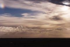 Cloudy sky with sundog Stock Photo