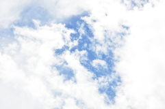 Cloudy on sky in sunny day Stock Photos
