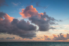 Cloudy sky in sunrise, Dominican republic. Atlantic ocean coast. Landscape with dramatic dark cloudy sky in sunrise, Dominican republic. Punta Cana. Bavaro beach Royalty Free Stock Photography