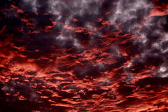 Cloudy sky at sunset. Dramatic sky at sunset with strong color, soft clouds and atmospheric effects Royalty Free Stock Photos