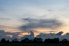 Cloudy sky with sunset in the evening. Royalty Free Stock Images