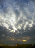 Cloudy sky. Cloudy sunset sky over a dark cityscape Royalty Free Stock Image