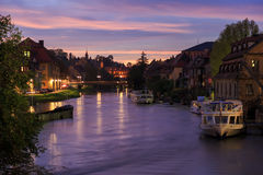Cloudy sky at sunset, Regnitz river with ships in Bamberg stock photography