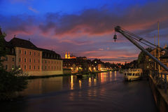 Cloudy sky at sunset, Regnitz river with ships in Bamberg Stock Image