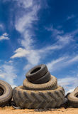 Cloudy sky tires of different sizes. Stock Images