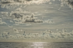 Cloudy Sky on turquoise tropical paradise sea Stock Photos