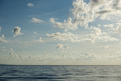 Cloudy Sky on turquoise tropical paradise sea Stock Image