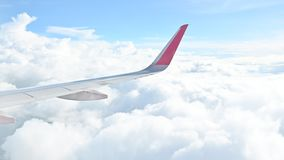Cloudy sky view from the airplane. Through window stock footage