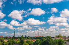 Cloudy sky and view of industrial landscape Royalty Free Stock Photo