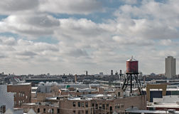 Water Tower on Top of City Buildings Royalty Free Stock Photo