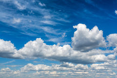 Cloudy sky. The white cloudy sky background Stock Photography