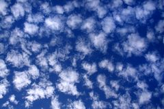 Cloudy sky in white and blue 03. Sheep clouds and a blue sky background Royalty Free Stock Photo