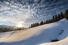 Cloudy sky at winter snow landscape Stock Photos