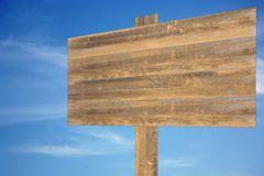 Cloudy sky with wooden sign Royalty Free Stock Photos