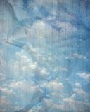 Cloudy sky on wrinkled paper Royalty Free Stock Image