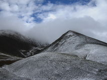 Cloudy snowy mountain Stock Photography