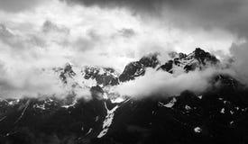Cloudy Snowy Mountain Range Panorama in Monochrome stock photo