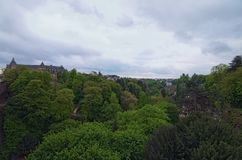 Cloudy spring morning in Luxembourg City. Downtown city, scenic view to the park and vintage buildings. Luxembourg City. Grand Duchy of Luxembourg royalty free stock images