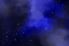 Cloudy starry night sky Stock Images