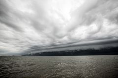 Cloudy storm in the sea before the rain. Tornado storms cloud above the sea. Monsoon season Stock Photos