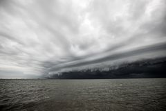 Cloudy storm in the sea before the rain. Tornado storms cloud above the sea. Monsoon season Royalty Free Stock Image