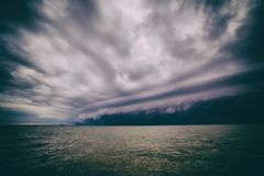 Cloudy storm in the sea before the rain. tornado storms cloud above the sea. Monsoon season. Hurricane Florence.  royalty free stock images