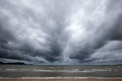 Cloudy storm in the sea before rainy. Tornado storms cloud above the sea. Monsoon season. Huge storm clouds with rain over sea , Strong winds, heavy rain storm royalty free stock photography