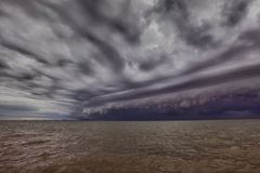 Cloudy storm in the sea before rainy.tornado storms cloud above the sea. Monsoon season. Storm in the sea.Wonder of natural disaster.Cloud before rain,Sky Royalty Free Stock Images