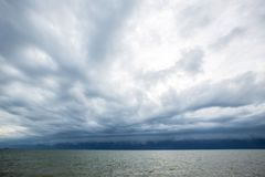 Cloudy storm in the sea before rainy. Tornado storms cloud above the sea. Monsoon season. Huge storm clouds with rain over sea , Strong winds, heavy rain storm Stock Photography