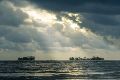 Cloudy stormy sky with sun ray breaking through Royalty Free Stock Image
