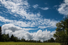 Cloudy summer landscape. Czech sunny countryside view, green meadow Royalty Free Stock Image
