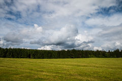 Cloudy summer landscape. Czech sunny countryside view, green meadow Stock Photo