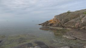 Cloudy summer morning on the cliffs. The peninsula of Hanko, Finland stock video footage