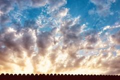 Cloudy summer sunset royalty free stock image