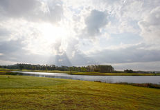 Cloudy sun and sky on golf course Royalty Free Stock Photography