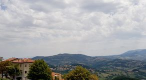 Cloudy sunny italian sky. Cloudy and sunny sky with Amazing italian summer landscape royalty free stock images