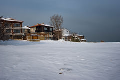 Cloudy, sunny winter day along the narrow streets of the town of Sozopol, Bulgaria Stock Image