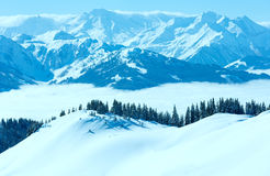 Cloudy sunny winter mountain landscape Stock Photo