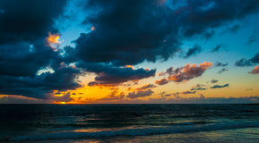 Cloudy Sunrise over Caribbean Sea. Photo of cloudy sunrise over Caribbean Sea - Mexico, Riviera Maya. Early morning Stock Image
