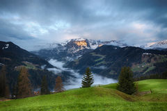 Cloudy sunrise over Dolomite mountains Stock Photos