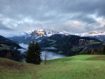 Cloudy sunrise over Dolomites mountains Stock Photography