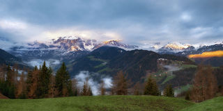 Cloudy sunrise over Dolomites mountains Stock Images