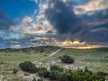 Cloudy sunrise over the dunes. At Hatteras Island, NC Stock Image