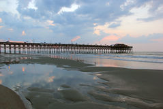 Cloudy sunrise over the ocean. Stock Photos