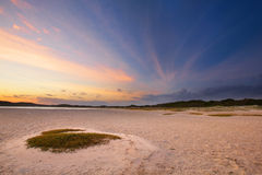 Cloudy sunrise over a quiet lagoon with cloud patterns and orang Stock Photo