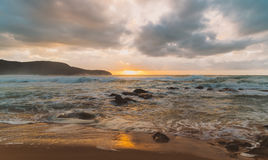 Cloudy Sunrise Seascape. Earthy tones at Killcare Beach, Central Coast, NSW, Australia Royalty Free Stock Image