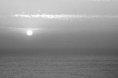 Cloudy sunrise (sunset) at sea Royalty Free Stock Image